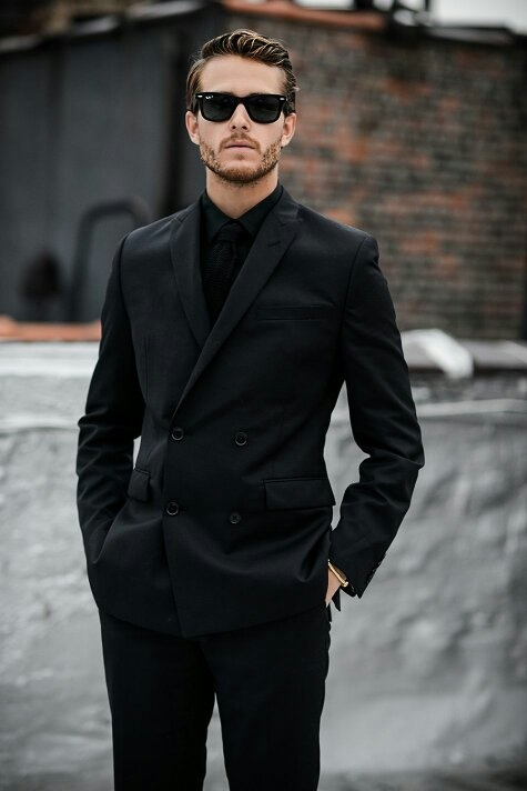 What do you think of businessmen who wear all black suits? Is .