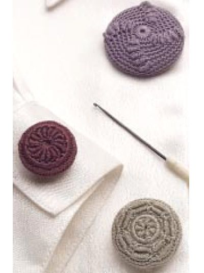 Vintage Buttons - Crocheted fashion with a touch of history .