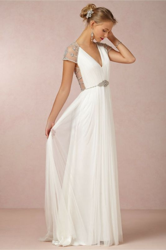 Picture Of a Grecian pleated A line wedding dress with a V .