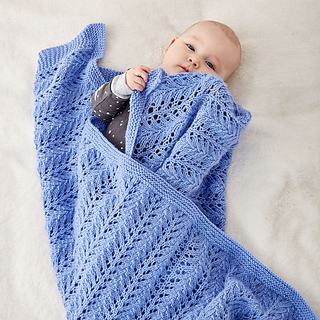 Ravelry: Lacy Knit Baby Blanket pattern by Yarnspirations Design .