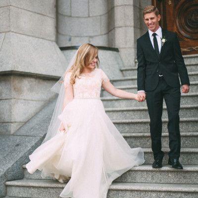 flowy modest wedding dress with blush lace from alta moda bridal .