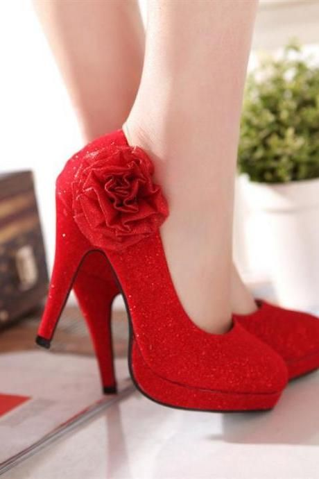 Red High Heels ~ umm maybe all black w/ the red rose or vice versa .