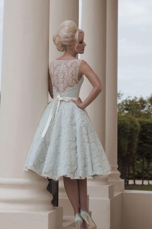 Contemporary sleeveless blue vintage tea length wedding dress .